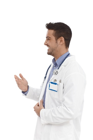 man face profile: Smiling young doctor talking, turning to right.