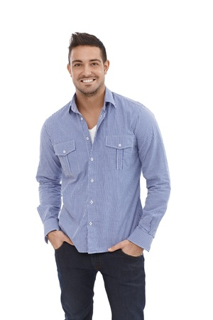 Casual young man smiling, hands in pocket. Stock Photo