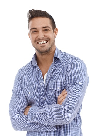 smiling young man: Portrait of confident young man smiling arms crossed.