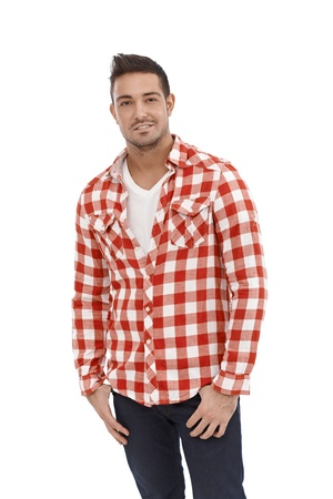 bristly: Casual young man standing in shirt and jeans.