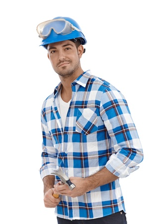 Young architect standing in hardhat, smiling. Stock Photo - 15032922