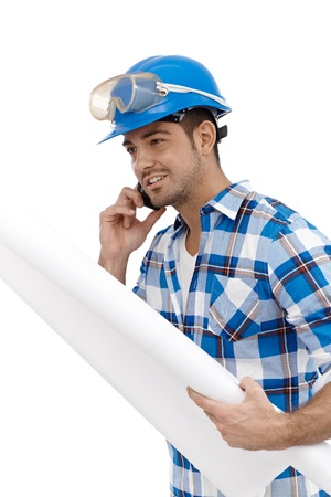safety googles: Young male architect on mobile phone busy by working. Stock Photo