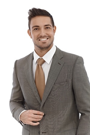 Portrait of elegant businessman smiling happily over white background. photo
