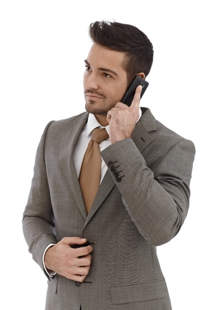 Young businessman talking on mobile phone, looking away. Stock Photo - 15033082