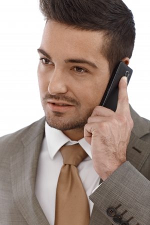 Closeup portrait of young businessman on mobile phone. Stock Photo - 15032936