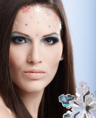 make up model: Beauty portrait of young model in professional makeup with rhinestones.