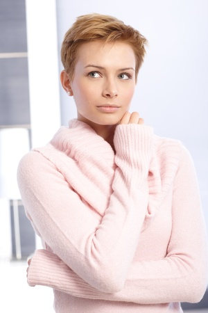 gingerish: Portrait of daydreaming young short hair woman. Stock Photo
