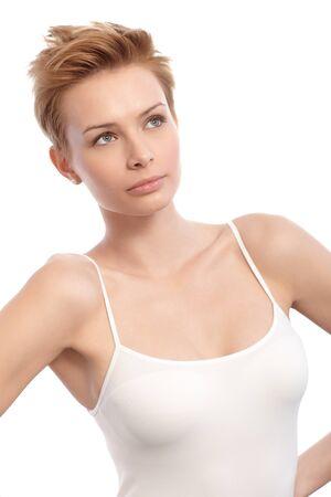 gingerish: Portrait of pretty short hair woman looking away, wearing top. Stock Photo