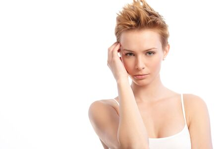 gingerish: Portrait of young attractive woman with trendy hair style, hand by face.