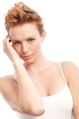 gingerish: Portrait of young woman in top, hand by face.