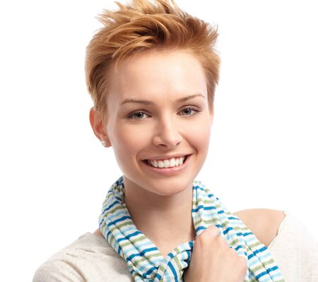 woman short hair: Closeup portrait of fresh woman with short gingerish hair, smiling.