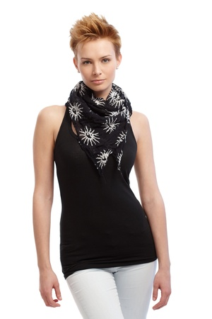 gingerish: Young attractive gingerish woman in black top and scarf standing over white background. Stock Photo