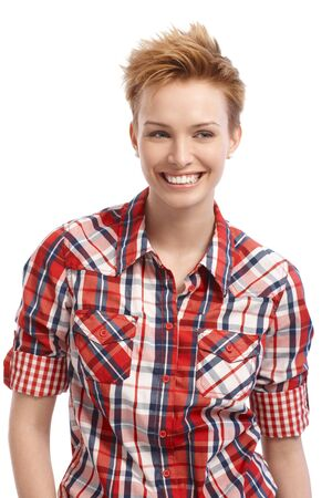 gingerish: Short hair gingerish woman smiling, looking away.
