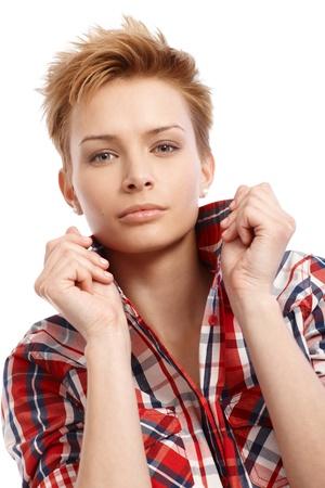 Closeup portrait of modern short hair gingerish girl, turning-up collar. Stock Photo - 15100745