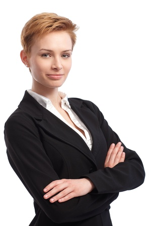 gingerish: Portrait of confident young businesswoman smiling arms crossed. Stock Photo