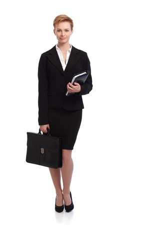 image size: Full size young businesswoman in black suit holding personal organizer and briefcase. Stock Photo
