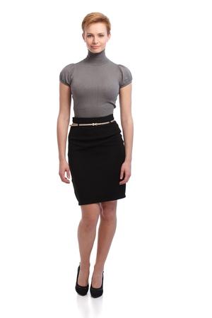 turtleneck: Pretty short hair businesswoman in skirt. Full size. Stock Photo