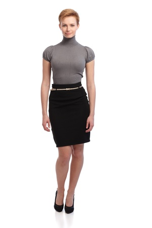 gingerish: Pretty short hair businesswoman in skirt. Full size. Stock Photo