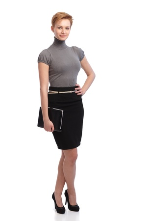 short skirt: Attractive young businesswoman holding personal organizer. Full size.