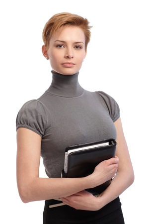 turtleneck: Portrait of pretty young businesswoman holding personal organizer. Stock Photo
