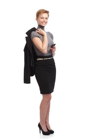 full size: Full size photo of businesswoman holding mobilephone, smiling happy.