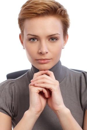 gingerish: Closeup portrait of attractive young businesswoman looking at camera. Stock Photo