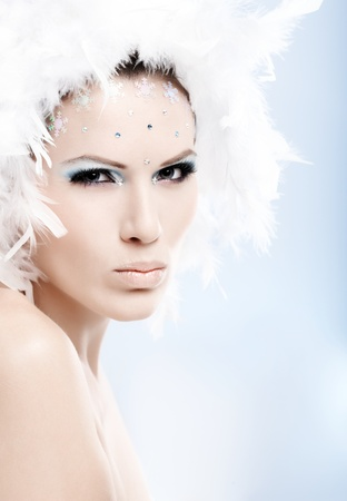 Winter beauty with a serious look and fancy makeup. photo