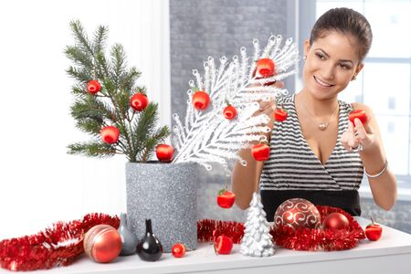 Happy woman getting ready for christmas, making stylish decoration at home, smiling. Stock Photo - 15286938