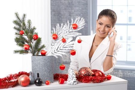 decorating christmas tree: Elegant woman decorating room for christmas with stylish ornaments. Stock Photo