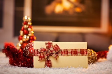 fireplace home: Christmas card and decoration on floor by cosy fireplace, selective focus. Stock Photo