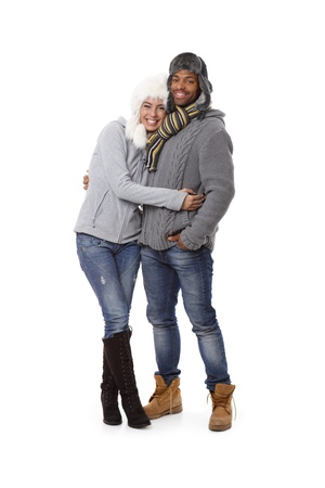 seasonal clothes: Winter photo of happy mixed race couple at wintertime. Stock Photo