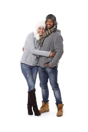 mixed race couple: Winter photo of happy mixed race couple at wintertime. Stock Photo