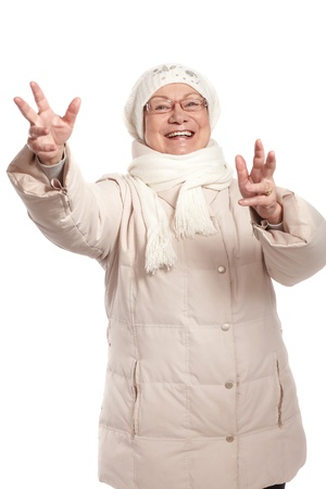 outspreading: Happy old lady smiling with open arms at wintertime.