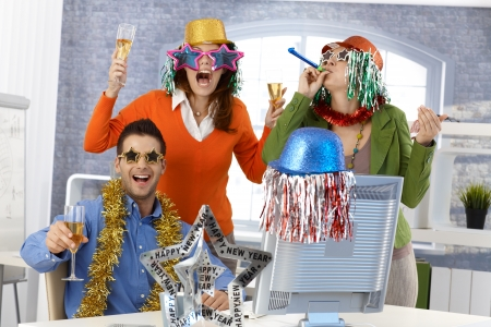 New year's eve party in office, team party with funny accessories. photo
