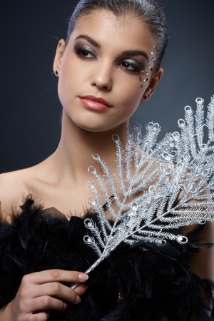 black boa: Smart beauty in fancy makeup, with party accessories, boa and silver branch fan.