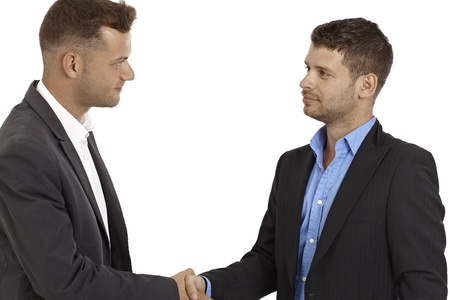 Young business partners shaking hands. Stock Photo - 15965780
