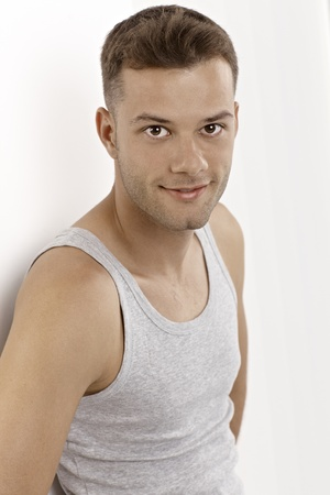 Portrait of smiling young man in vest. Stock Photo - 15965789