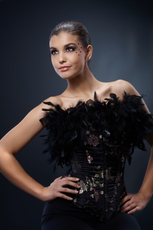 black boa: Attractive woman posing in black party dress with boa, luxury makeup, smiling. Stock Photo