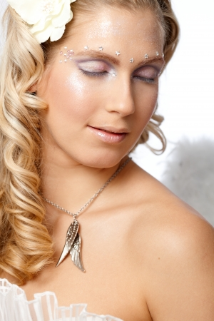 rhinestones: Young woman with angel face and professional makeup.