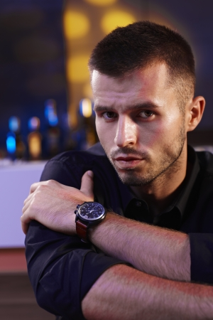 Closeup portrait of handsome young man in black shirt, looking at camera. Stock Photo - 16859434