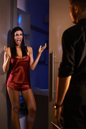 nightdress: Sexy woman shouting happy when man arriving from work.