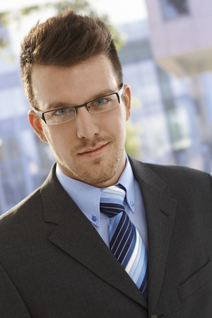 bristly: Closeup portrait of elegant young confident businessman. Stock Photo