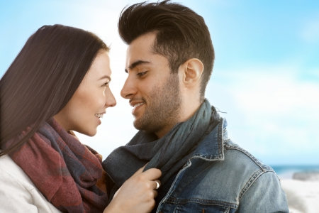 be kissed: Young attractive loving couple kissing on the beach at autumn. Stock Photo