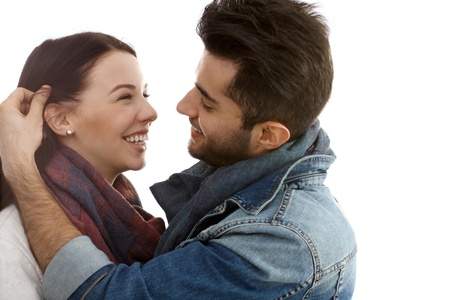 be kissed: Happy young romantic couple embracing and kissing at autumn. Stock Photo