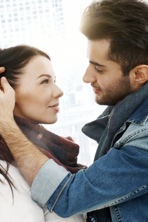 be kissed: Romantic young couple kissing in the city, embracing. Stock Photo