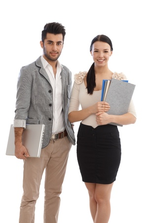 Happy young businesspeople holding files and laptop. Stock Photo - 17083882