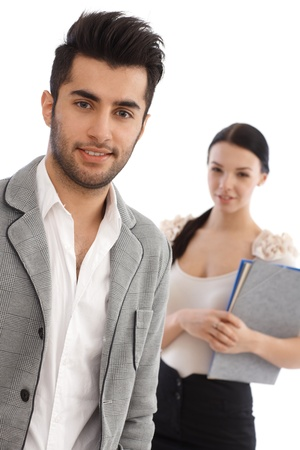 Portrait of handsome young businessman, woman standing behind. Stock Photo - 17083798