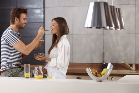Romantic young couple having breakfast in the kitchen. photo