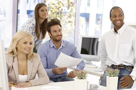 Happy businessteam working in bright office.