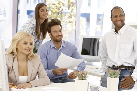 Happy businessteam working in bright office. Stock Photo - 17132678